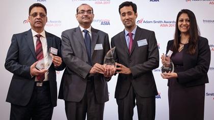 Chandra Mohan Grover, Pradeep Garg, Lalit Khilani and Ruchi Mittal standing on stage