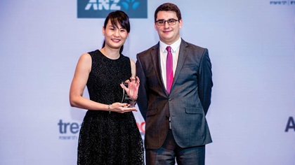 Angeline Yeo and James Hayward standing on stage