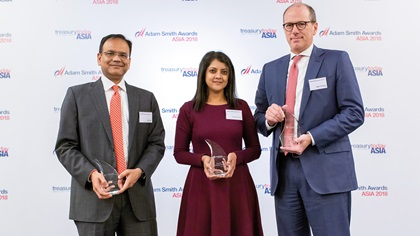 Ajay Jain, Standard Chartered, Debopama Sen, Citi and Mark Troutman, DBS collect the award on behalf of Vedanta Resources Plc