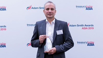 Photo of Gourang Shah, J.P. Morgan collects the award on behalf of Tencent Financial Technology Group