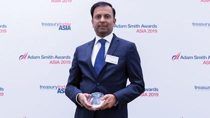 Photo of Pradeep Nair, Standard Chartered collects the award on behalf of Digital Guangdong Co Ltd