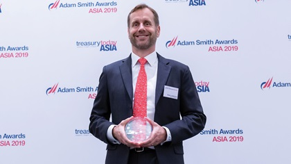 Photo of Stefan Leijdekkers, Bank of America, collects the award on behalf of Linamar Corporation