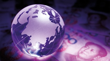 Glass globe on top of Yuan notes