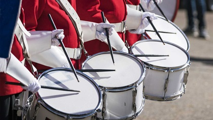Red uniformed drummers in a row