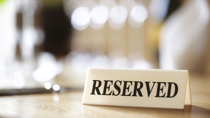 Restaurant table with reserved sign