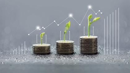 Plants growing out of coins with graph overlay