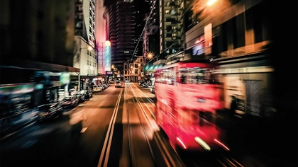 Abstract cityscape with red bus