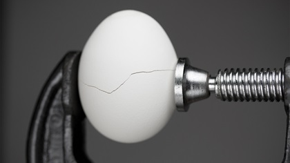 Egg in a vice, causing pressure on the egg which caused a crack