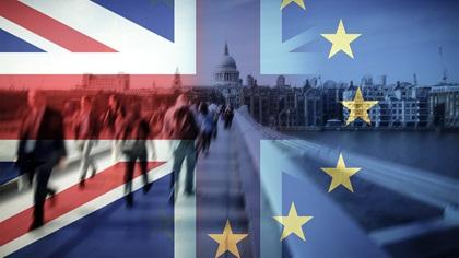 People walking on London bridge with the UK and EU flags overlayed