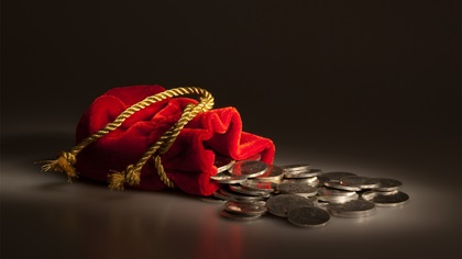Red money purse with gold string loosened to release coins
