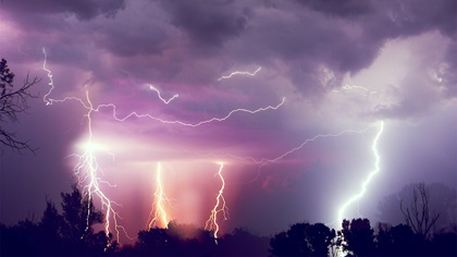 Dramatic purple stormy sky with lightning hitting the group