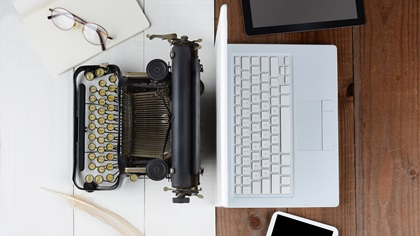 Overhead shot of old fashioned typewriter and laptop