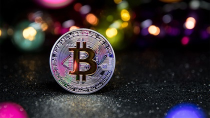 Physical bitcoin standing up on ground