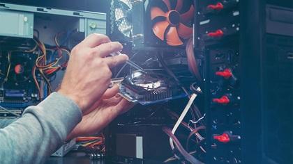 IT technician repairing PC
