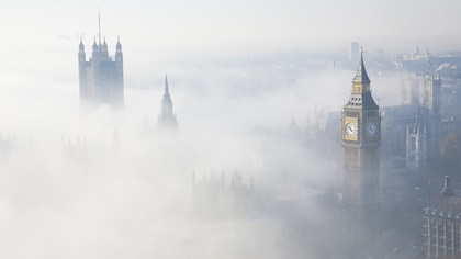 London city surrounded in fog