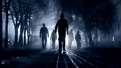 Silhouettes of zombie people walking