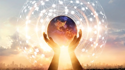 Person holding the Earth in their hands with technology hologram surrounds