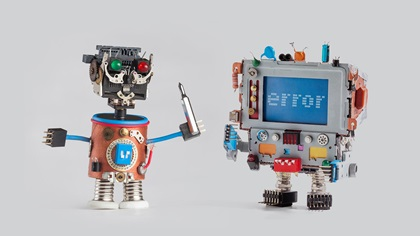 Two small robots, one with an error and the other with a tool trying to fix it