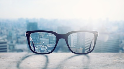 Blurred city in the background until glasses rectify vision