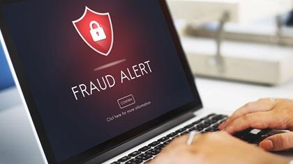 Scam fraud alert message on laptop