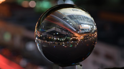 Crystal ball reflecting cityscape upside down at night