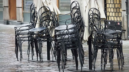 Stacked chairs, empty cafe