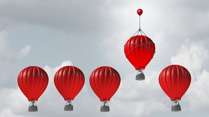 Red balloons and one is rising higher than others