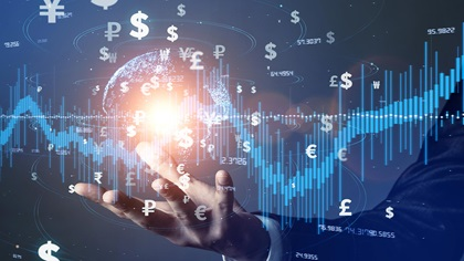 Person holding up digital global with multiple currencies and graphs