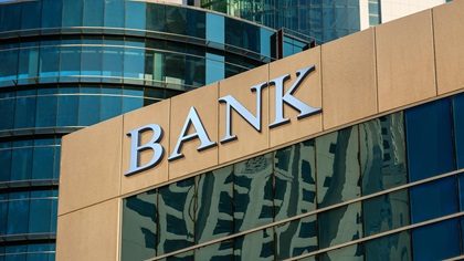 Building in city with Bank sign