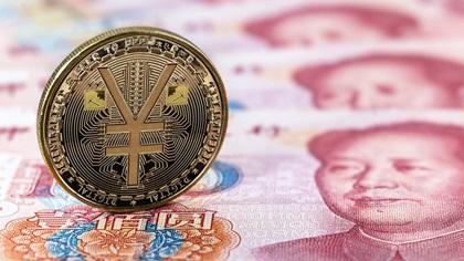 Digital Yuan coin on Yuan notes