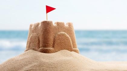 Sandcastle standing on a beach