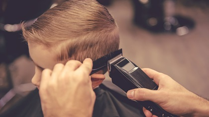 Little boy getting hair cut