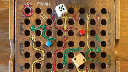 Old style board game of snakes and ladders