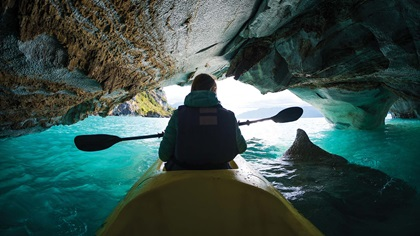 Person in a kayak exploring water cave