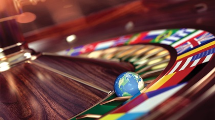 Illustration of the earth on a roulette table with country flags