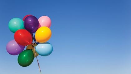 Photo of balloons on string