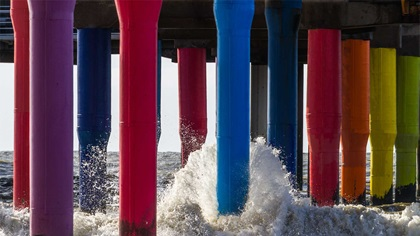 Multi coloured posts of a jetty