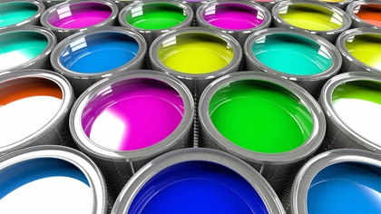 Multiple open paint cans with different colours inside