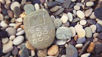 Mobile phone from stones on beach