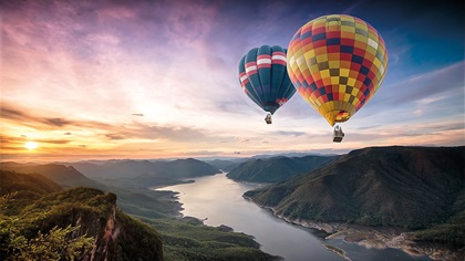 Beautiful scenery with hot air balloons flying over