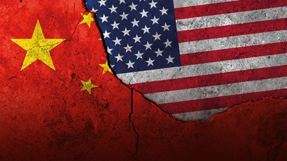 US and China flags on concrete, breaking into each other
