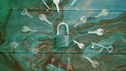 Keys surrounding lock with liquid overlaid