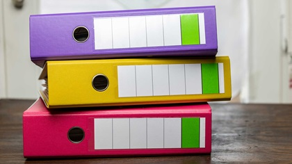Colourful folders on a desk in a study