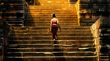 Woman climbing up stone stairs