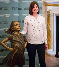 Lynn Lochhead from John Lewis having her photo taken with the Fearless Girl