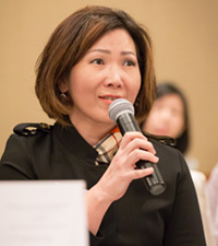 Woman asking question during forum