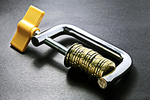 Gold coins stuck in a clamp