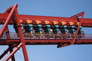 Roller coaster car climbing lift hill