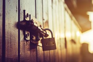 Old and rusty lock on wooden door