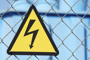 High voltage sign on fence